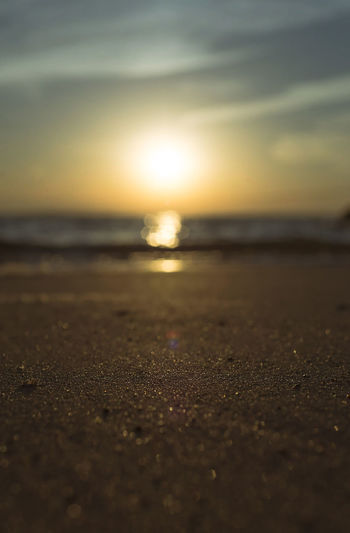 Beach Beauty In Nature Horizon Horizon Over Water Land Nature No People Outdoors Sand Scenics - Nature Sea Selective Focus Sky Sun Sunlight Sunset Surface Level Tranquil Scene Tranquility Water