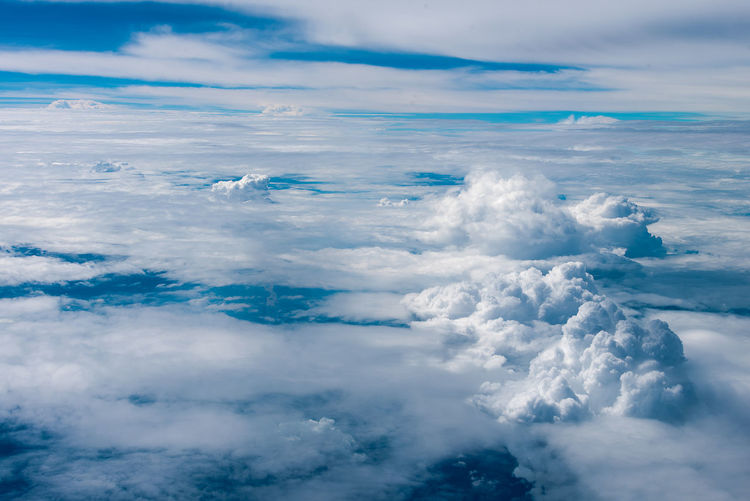 Aerial view of cloudscape over sea against sky