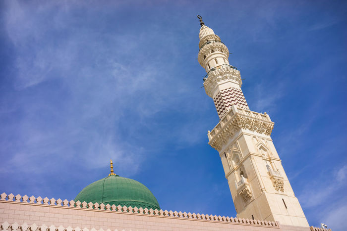MEDINA, SAUDI ARABIA - 15TH NOV 2017; External view of Mosque Al-Nabawi in Medina, Saudi Arabia. It is the second-holiest site in Islam and the mosque was built by Prophet Muhammad in 622. Medina Al Munawarah Nabawi Mosque Pray Prophet Muhammad Architecture Building Exterior Built Structure Day Dome Islam Low Angle View Minaret Muslim No People Outdoors Place Of Worship Religion Sculpture Sky Spirituality Travel Destinations