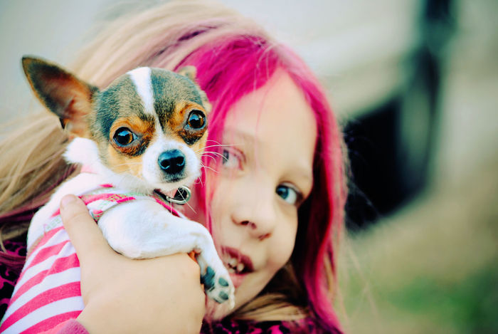 A Girl And Her Dog Close-up Cute Day Domestic Animals Focus On Foreground Lifestyles Mammal Pets Pink Color Pink Hair Portrait