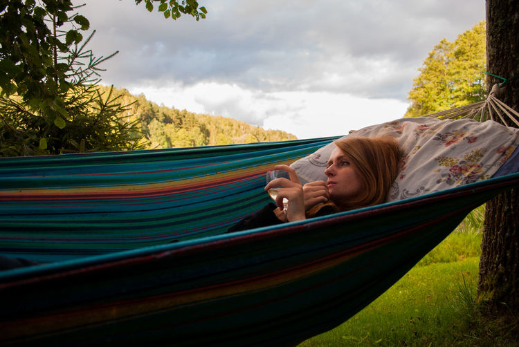 This is just too relaxing picture to write any description here. This is what summer is all about: hammocks, wine and doing absolutely nothing. Casual Clothing Chill Cloud - Sky Clouds Cloudy Day Elementary Age Girl Hammock Hammock Time Hand Leaves Lines Outdoors Relax Relaxation Relaxing Resting Shadows Side View Sky Sky And Clouds Summer Trees Wine
