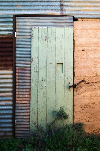 Abandoned building in Silverton, NSW Australia. Abandoned Places Building Exterior Door No People Old Ruin Olddoor Light And Shadow Outdoors Naturetakingover Australia Australia & Travel Australian Bushland Red Nature Complimentary Colors