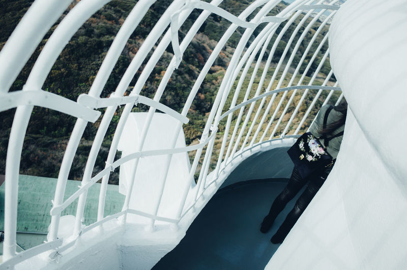 Japan Travel Destinations Travel Japan Travel Exceptional Normalcy Enjoying Life People Minimalism Woman Women Abstract Hide And Seek High Angle View Lines And Shapes Passage One Person Architecture Built Structure Real People Day Bridge Railing Men Building Exterior Lifestyles Outdoors Leisure Activity Bridge - Man Made Structure Glass - Material Staircase Metal Standing Transportation My Best Photo International Women's Day 2019