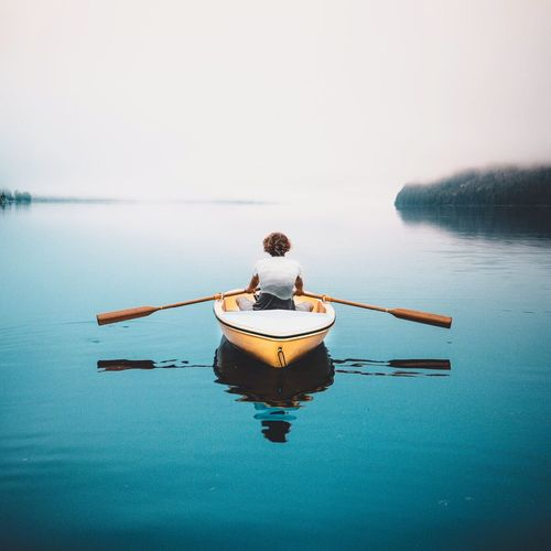 EyeEm Selects Water Rear View One Person Full Length Sitting Nature Real People Sea Tranquility Beauty In Nature Outdoors Day Clear Sky Scenics Nautical Vessel Sky Young Adult Adult People Adults Only Fresh On Market 2017