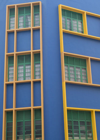 Singapore architecture Outdoors Singapore Architecture Architecture_collection Architecture Photography Window Building Exterior Building No People Built Structure Day Yellow Blue City Façade Residential District Repetition Low Angle View In A Row Glass - Material Pattern Backgrounds Apartment Window Frame Chinatown