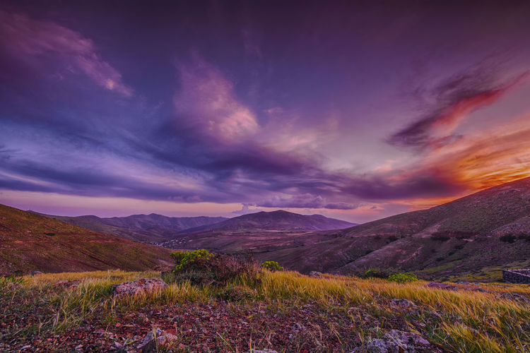 Nature Autumn Beauty In Nature Cloud - Sky Clouds And Sky Day Dramatic Sky Evening Grass Landscape Mountain Mountain Range Nature No People Outdoors Purple Scenics Sky Sunset Tranquil Scene Tranquility