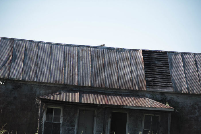 Derelict Falling Apart The Week On EyeEm Architecture Beat Up Building Exterior Built Structure Clear Sky Day Low Angle View No People Outdoors Roof Sky Tin Roof