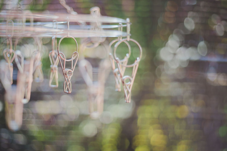 Close-Up Of Clothespins Hanging Outdoors