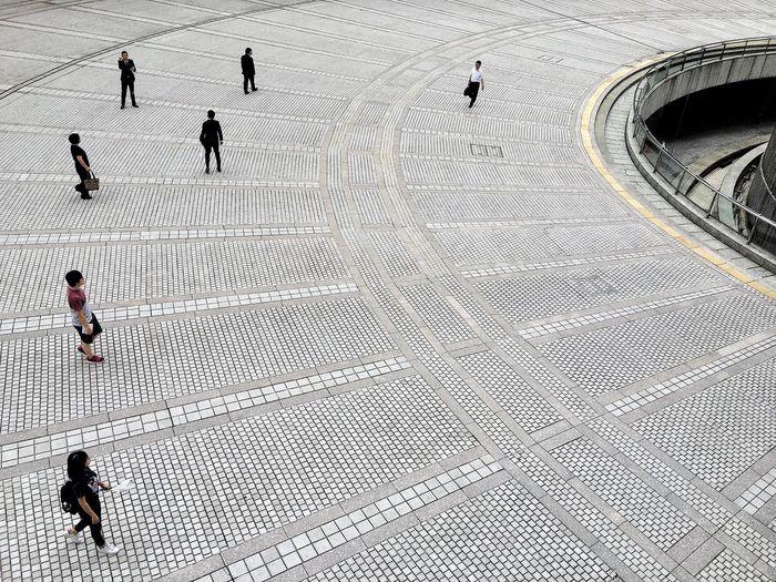 High angle view of people walking on walkway