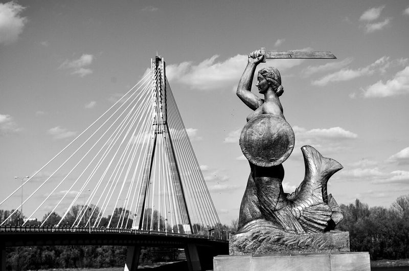 Low Angle View Of Statue Against Bridge
