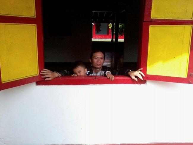 Kidsportrait In Window