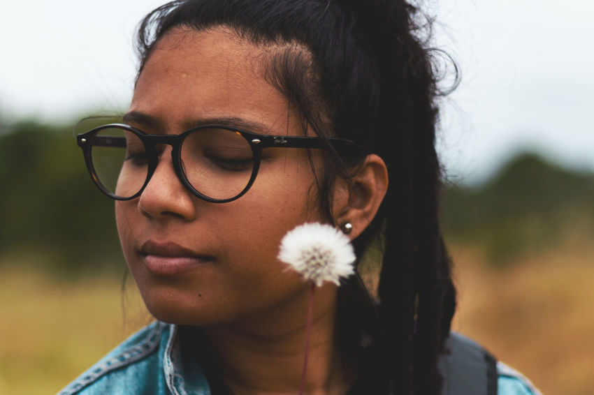 Child Close-up Contemplation Day Eyeglasses  Focus On Foreground Front View Glasses Hairstyle Headshot Leisure Activity Lifestyles Looking Looking Away Nature One Person Outdoors Portrait Real People Teenager Young Adult The Portraitist - 2018 EyeEm Awards The Great Outdoors - 2018 EyeEm Awards