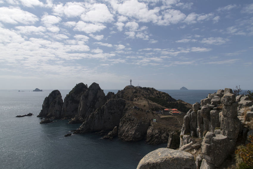 seaside view of Somaemuldo Island in the sea of Tongyeong, Gyeongnam, South Korea. Taken with Nikon d850. Blue Sea Island View  Nature's Beauty Nikon D850 Tongyeong Tranquility Beauty Of Nature Blue Sky Cliff And Sea Cloud And Sky D850 Island Outdoor Outdoor Photography Outdoors Sea And Sky Sea Cliff So Cool Nature Somaemuldo Splendid Nature Tourism Tranquil Scene Travel Destinations
