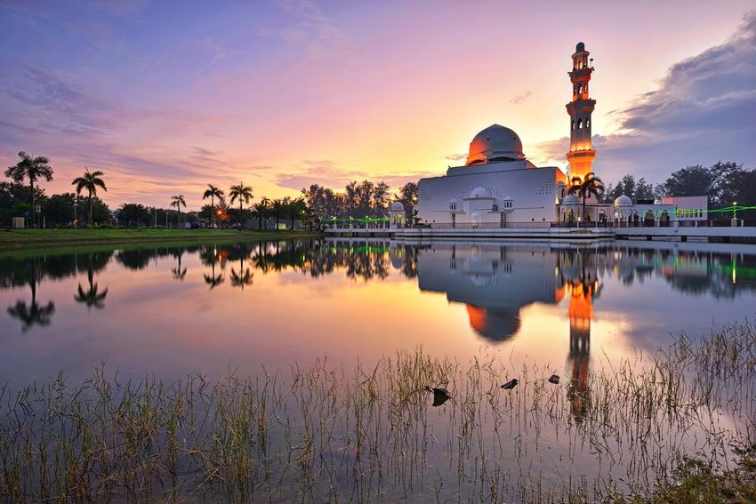 Sunrise reflections over the beautiful mosque Beauty In Nature Sky Cityscape Skyline Lake Nature Landscape Travel Travel Destinations Sky And Clouds Sunrise Sunset_collection Getty Images EyeEm Selects Mosque Masjid Architecture Built Structure Beauty Sunset Place Of Worship City Dawn Water Arrival Religion Reflection Cultures Reflection Lake Pilgrimage Building