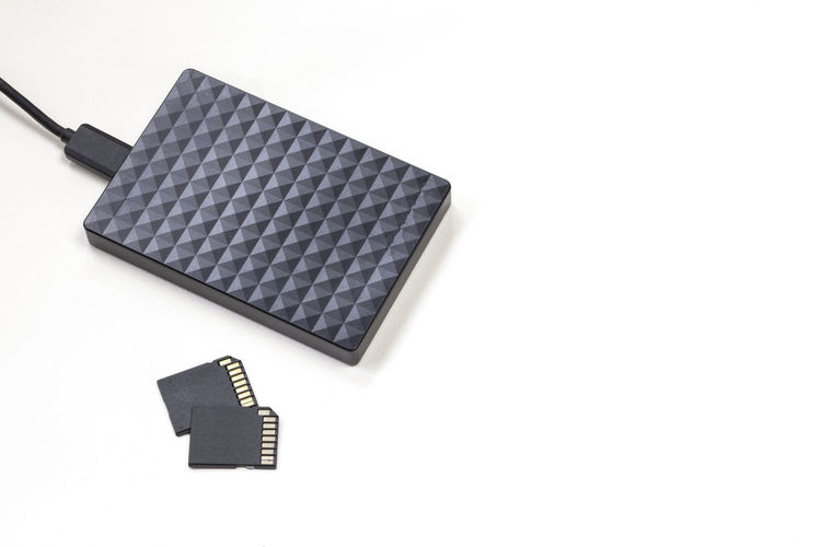 High angle view of laptop on table against white background
