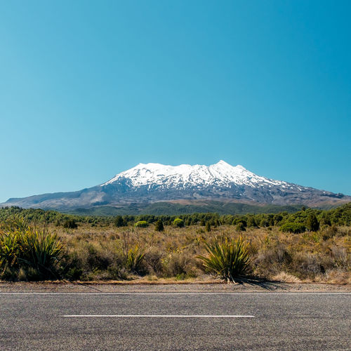 Scenic view of mount ruapehu in new zealand against clear blue morning sky
