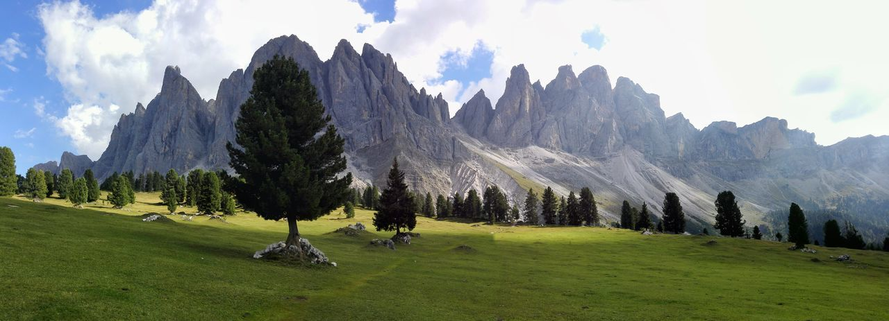 Dolomites Panoramic Landscape Tree Sky Mountain Tranquil Scene Mountain Range Scenics Grass Beauty In Nature Tranquility Green Color Nature Non-urban Scene Cloud Outdoors Solitude Remote Day Cloud - Sky