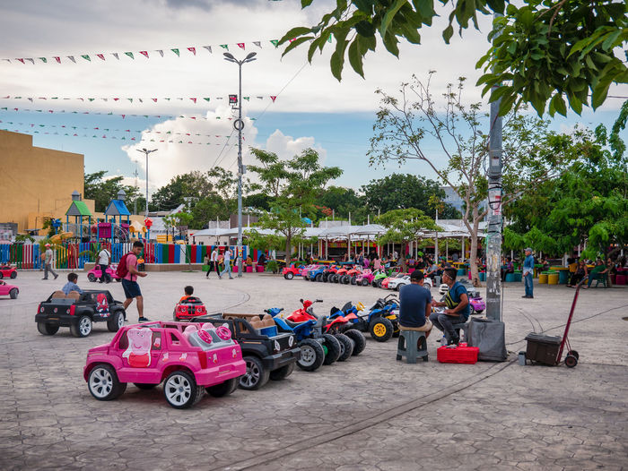 Children's Car Carousel in the square, El Parque de las Palapas, Cancún, Mexico, in September 8, 2018 8, 2018 Cancun Mexico Architecture Building Exterior Built Structure Car Carribean City Cloud - Sky Day Decoration Group Of People Incidental People Land Vehicle Mode Of Transportation Motor Vehicle Nature Outdoors Plant Real People Sky Street Transportation Tree