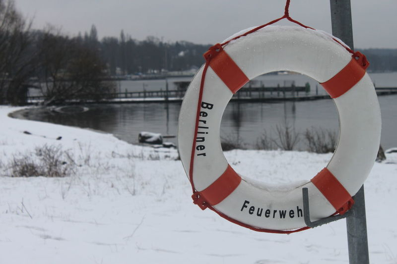 rescue ring Berliner Feuerwehr Berliner Feuerwehr Lake In Winter Wannsee Berlin Beauty In Nature Close-up Cold Temperature Communication Day Hanging Life Belt Nature No People Outdoors Rescue Ring Sky Snow Text Wannsee Winter