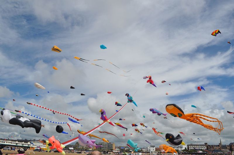 Second Acts EyeEm Selects Sky Low Angle View Flying Cloud - Sky Kite Multi Colored Celebration Outdoors Mid-air Day Kite - Toy Large Group Of People Nature Real People Kite Festival Kites Kite Flying Beach New Beginnings Kite Group Of Objects Nikon People Crafted Beauty
