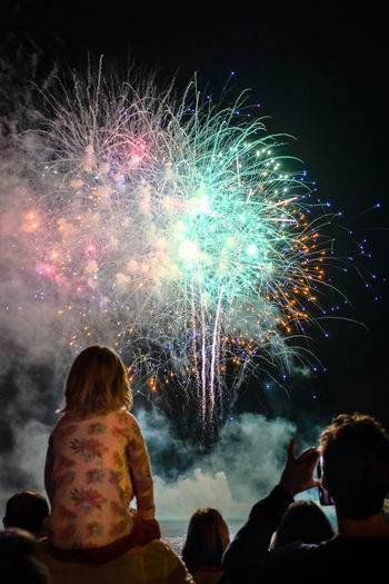 Barcelona, Spain - September 23, 2017: People are watching great fireworks at the coast of Barcelona, Spain during the La Mercè Festival, a large party all over the city to worship the patron saint La Mercè. EyeEmNewHere Fireworks La Merce Festival Arts Culture And Entertainment Celebration Event Exploding Festival Firework Firework - Man Made Object Firework Display Illuminated La Merce Leisure Activity Lifestyles Men Motion Multi Colored Night Outdoors People Real People Smoke - Physical Structure Togetherness