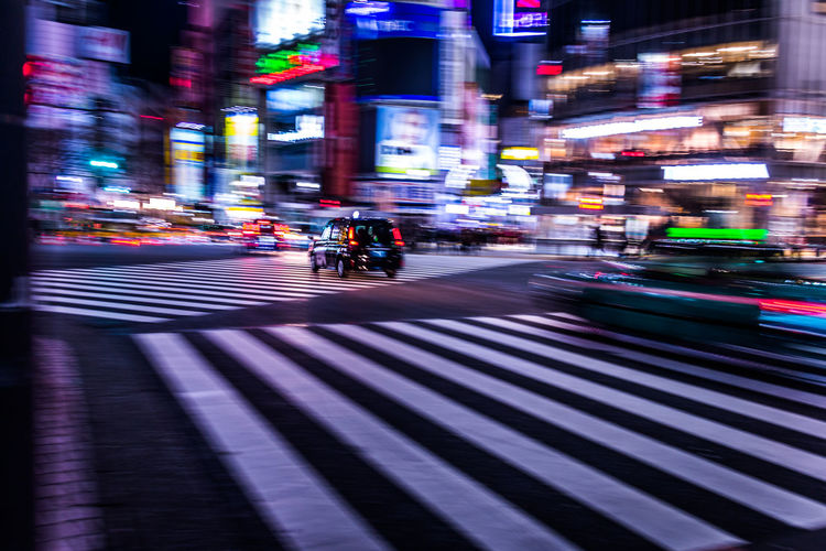 Business Finance And Industry Business Technology Tech Acceleration Business Acceleration Neon Futuristic Development Revolution Algorithm Analytics Speed Transportation Japan Tokyo Intersection Zebra Crossing Shibuyascapes Blurred Motion Motion Blur Street Abstract Traffic City Architecture Night Crosswalk Road Road Marking Building Exterior Illuminated Crossing Mode Of Transportation City Life Motion Sign Marking City Street Symbol Outdoors Nightlife Cityscape Humanity Meets Technology My Best Photo