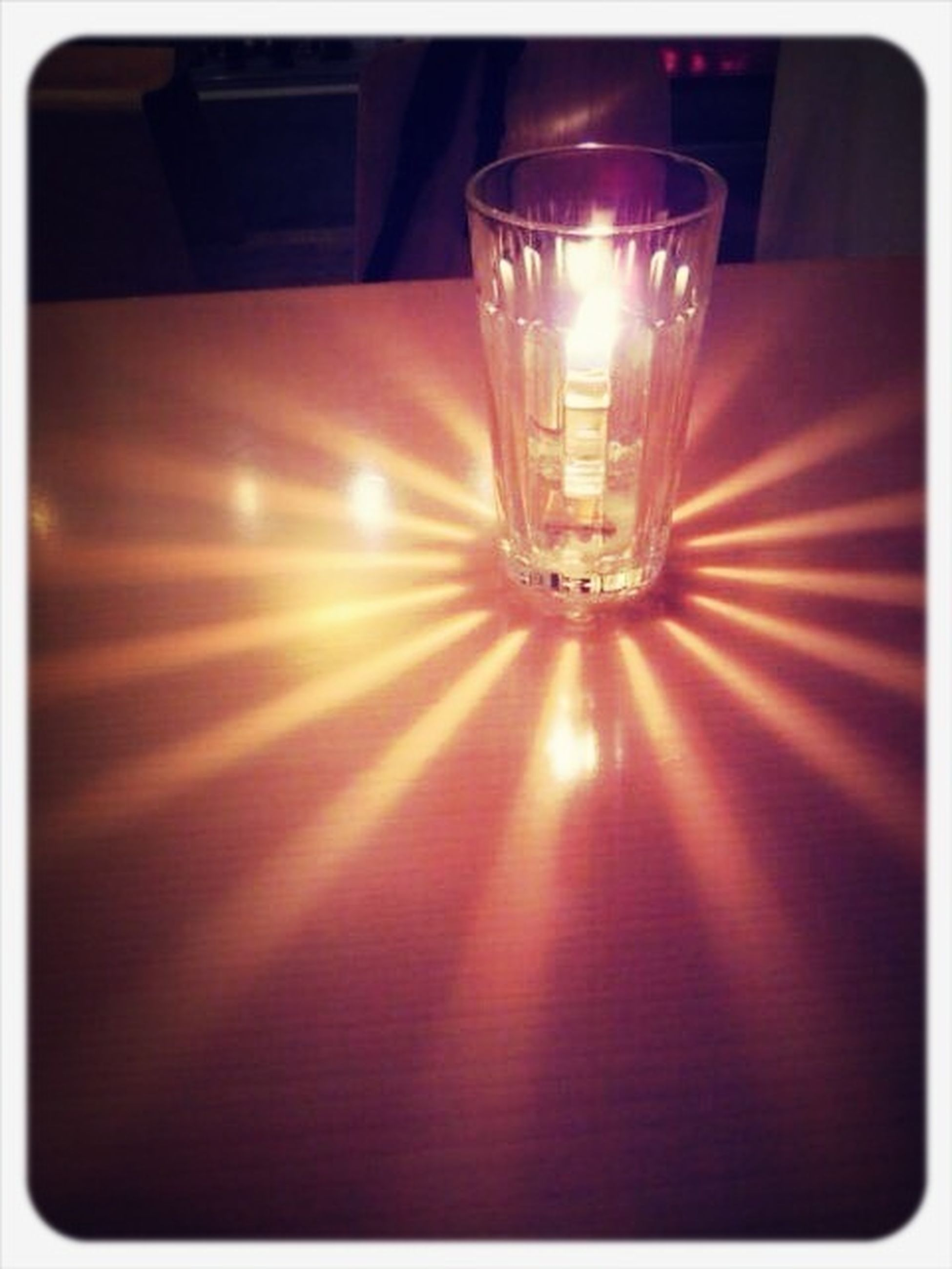 indoors, illuminated, transfer print, lighting equipment, glowing, auto post production filter, lit, light - natural phenomenon, close-up, glass - material, electric light, electricity, table, no people, decoration, light, candle, electric lamp, ceiling, home interior
