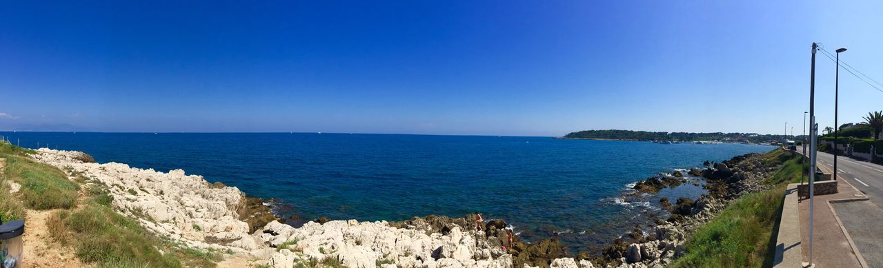 Panoramic View Of Shore And Sea Against Clear Sky