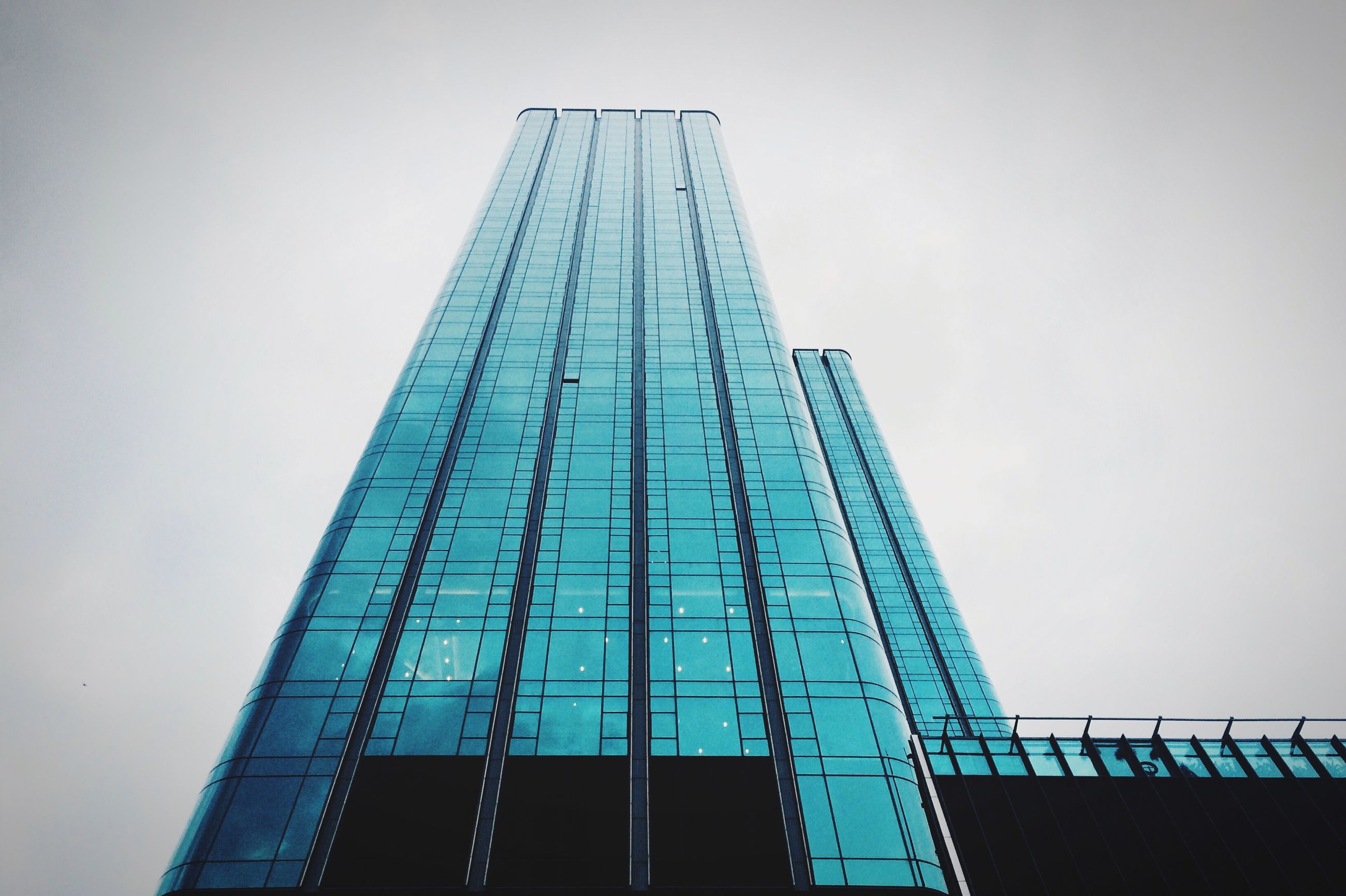 architecture, built structure, building exterior, low angle view, tall - high, clear sky, skyscraper, tower, city, modern, office building, copy space, building, tall, development, sky, day, outdoors, no people, capital cities