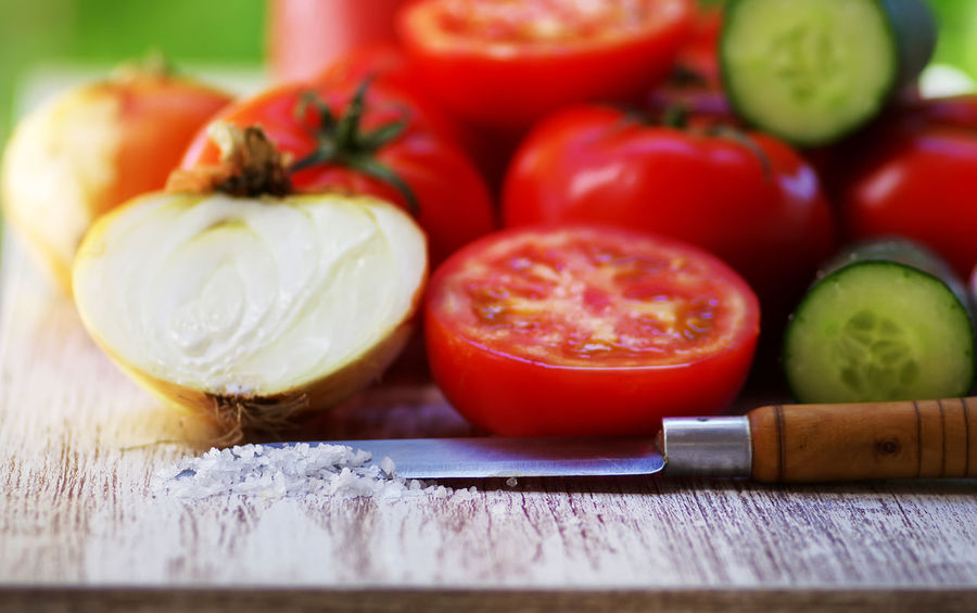Red tomatoes , onion, salt, kitchen knife on table Salt Knife Red Tomatoes Close-up Food Food And Drink Fruit Healthy Eating Onion Red Ripe SLICE Table Tomato Vegetable