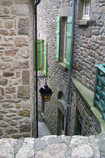 Mont-Saint-Michel  Back Street Corner Lamp Passage Green Shutters Against-diving Normandie Lamp Lampadaire Gutters Eclairage Public Structure Batie Rocks Rock - Material Angle De Prise De Vue Prise De Vue Extérieure Vintage4 Vertical EyeEm Best Shots - Architecture In Mont-Saint-Michel-Normandie