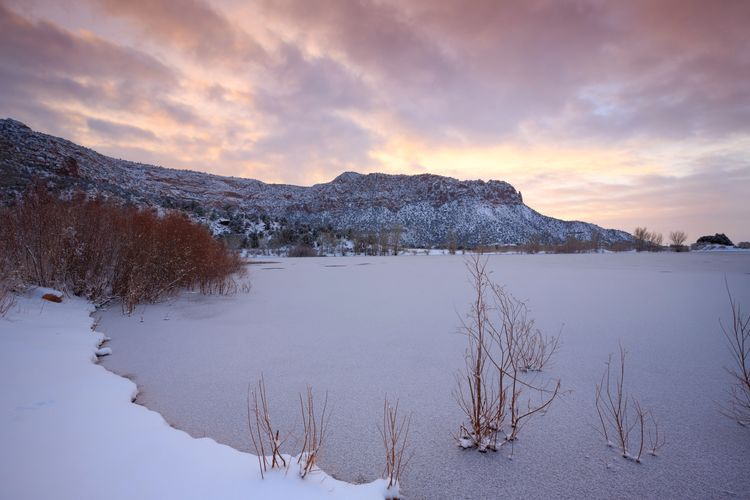 Scenic View Of Lake Against Cloudy Sky During Winter
