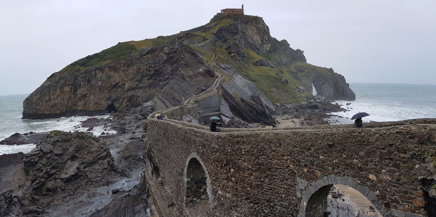 Games Of Thrones Gaztelugatxe San Juan Architecture Beauty In Nature Cliff Dragonstone Full Length Got Horizon Over Water Juegodetronos Men Nature Outdoors Rocadragon Rock Formation Scenics Sea Tranquility