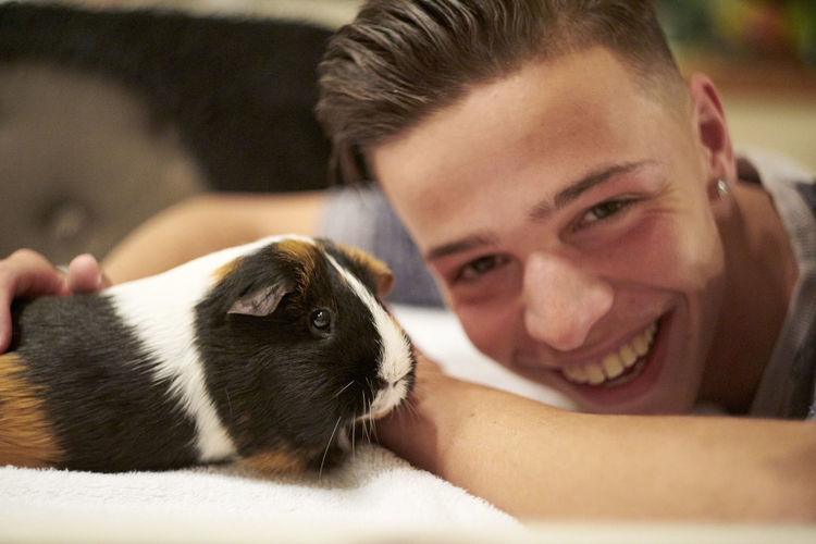 Animal Themes Bonding Close-up Day Domestic Animals Friendship Happiness Indoors  Looking At Camera Mammal One Animal One Person People Pets Portrait Real People Smiling Young Adult
