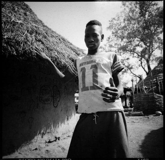 Neymar Jr in Mali Analogue Photography Brazil Football Football Fans Worldwide Football In Africa Mali Mali Village Neymar  Round Hut Travel Worldcup 2018 Black And White Photography Counterfeit Counterfeit Sportswear Futebol Grain Neymar Fan Neymar Jr Neymar Jr Shirt Outdoors Portrait Seleção Brasileira Village The Portraitist - 2018 EyeEm Awards