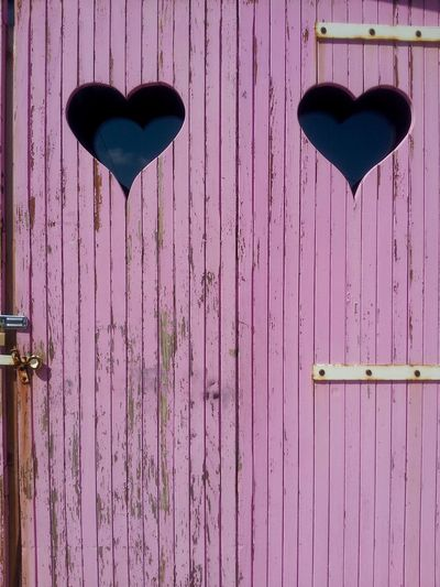 Heart shape on pink door
