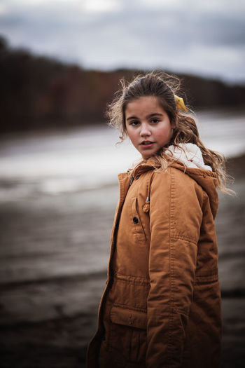 Portrait of cute girl standing at beach