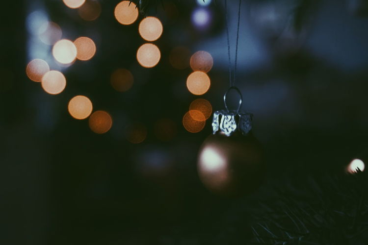 Close-Up Of Decoration Hanging On Christmas Tree At Night