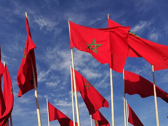 Red flags against sky