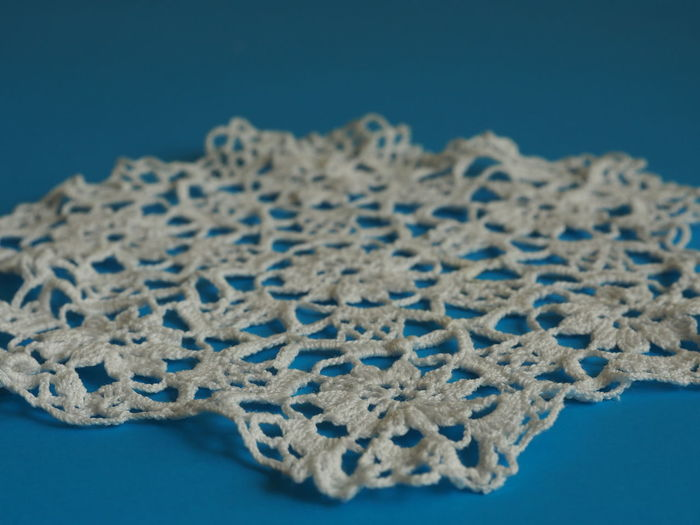 Close-up of place mat on blue background