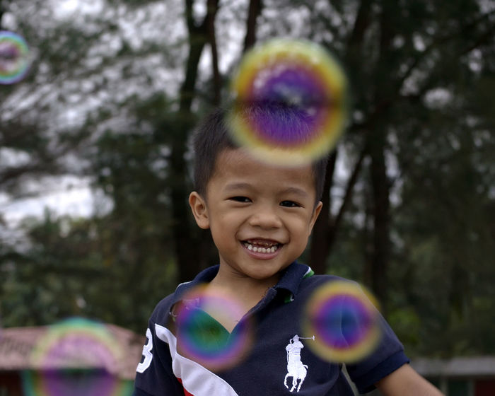 amazing boy happily playing water bubbles Balloons Birthday Boy Favourite Happy Time Hobby Kiddy Playing Rousing Water Bubbles Wind