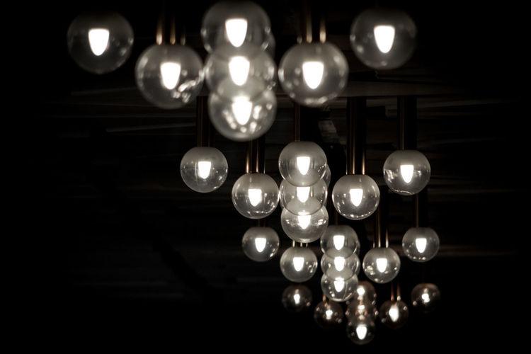 Low angle view of illuminated pendant lights