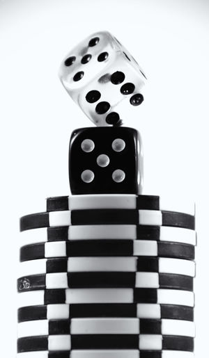 Ode to Las Vegas! Gambling fun! Betting Black And White Close-up Dice Focus On Foreground Gambling Indoors  Large Group Of Objects Las Vegas Leisure Games Man Made Object Repetition Single Object Still Life Studio Shot Table White Background