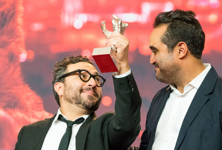 Berlin, Germany - February 24, 2018: Alonso Ruizpalacios and Manuel Alcala, winner of the Silver Bear for Best Script for 'Museo', pose at the red carpet after the closing ceremony of 68th Berlinale AWARD Closing Ceremony Film Festival Alonso Ruizpalacios Arts Culture And Entertainment Berlinale Berlinale 2018 Berlinale Festival Berlinale2018 Celebration Entertainment Entertainment Event Film Director Film Producer Holding Manuel Alcala Mass Media Men Posing Prize Red Carpet Red Carpet Event Silver Bear Two People Winner