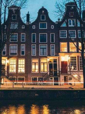 Amsterdamcity Amsterdam Building Exterior Architecture Built Structure Window Waterfront Water Outdoors Travel Destinations No People Sky Bare Tree