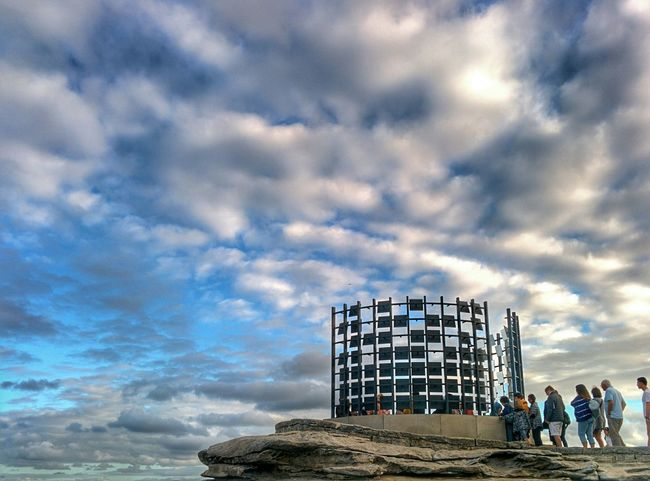 Mirror Mirrors Skyporn Sky People Photography Sculpture Sculpturebythesea Light And Shadow Hanging Out Taking Photos Eye4photography  EyeEm Best Shots Clouds And Sky Silhouette People moving inside a seaside mirror sculpture Urban Asymmetry Contrast Nexus5 Urbanphotography Urban Landscape Seaside Landscape Blue Sydney Bondi