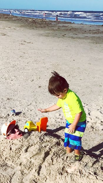 Buried in the sand Beach Sand Childhood Summer Boys Vacations Outdoors Child Buried In Sand Buried Alive The Week On EyeEm EyeEm Best Shots EyeEmNewHere Togetherness Lifestyles Family Time Family Sea Beach Photography Dump Truck Toys Playing Sunnyday☀️ Sunny Afternoon Sunny Day