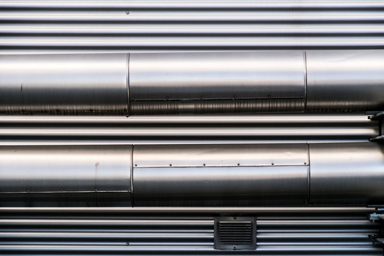 Close-up of metal pipes in factory