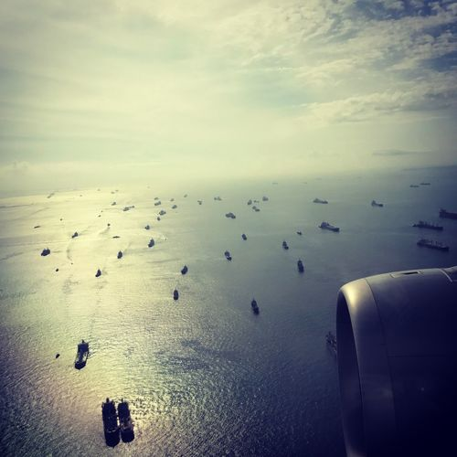Singapore straight Quatar A350 Singapore Shippingworldwide Boats Large Group Of Animals Water Sky Nature Sea Beauty In Nature Outdoors No People Horizon Over Water Flying