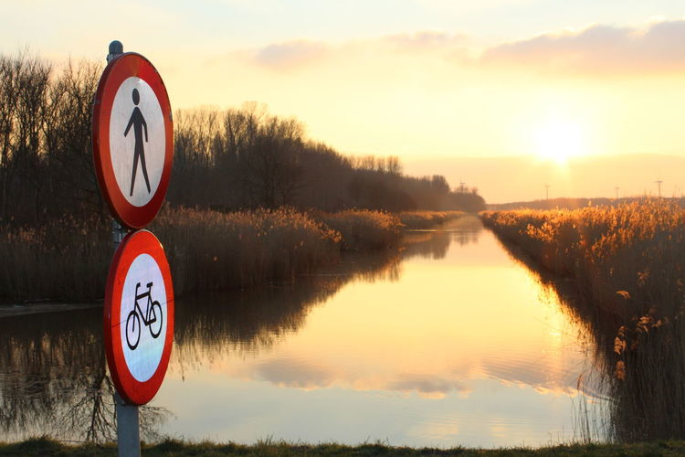 Almere Almere Poort Ditch First Eyeem Photo Holland❤ Nature Nederland Netherlands Noorderplassen Ondergaande Zon Sky Sunset Traffic Sign Verkeersbord No Filter Perspective Landscapes With WhiteWall Landscape